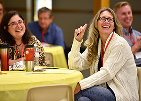 Annette Lee, left, and Michelle Allen, both of St. Michael Parish in Bedford, laugh while listening to stewardship coach Tracy Earl Welliver during Parish Stewardship Day Oct. 17. (NTC/Ben Torres)